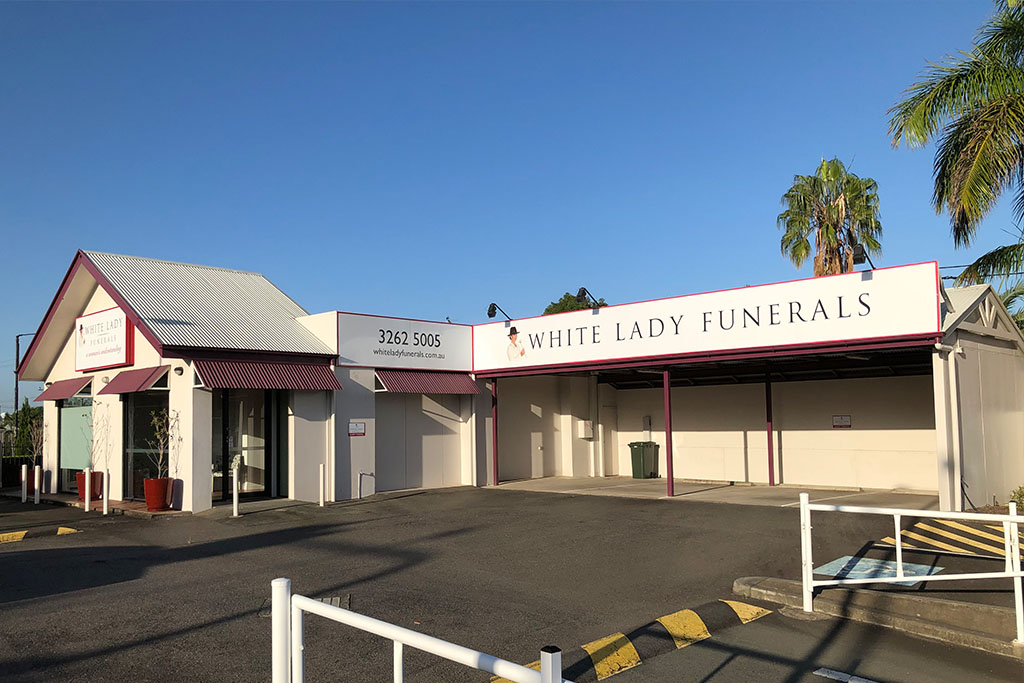 White Lady Funerals InvoCare facility sign
